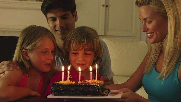 Boy blowing  candles on birthday cake. Royalty-free stock video