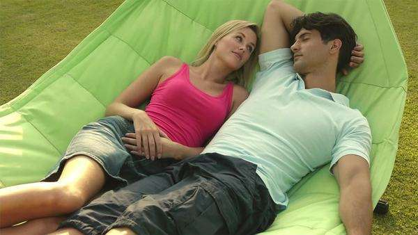 Young couple in hammock in garden. Royalty-free stock video