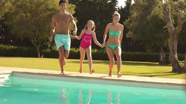 Slow motion of family jumping in pool. Royalty-free stock video