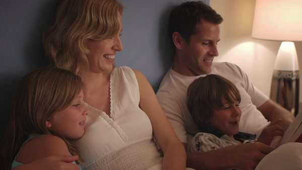 Family reading in bed together. Royalty-free stock video
