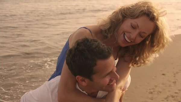 Slow motion shot of playing couple on beach. Royalty-free stock video