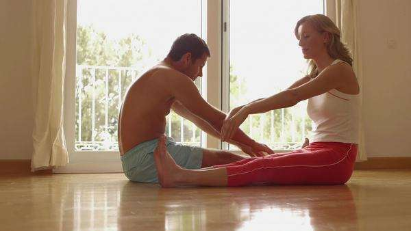 Couple doing stretching exercises together. Royalty-free stock video