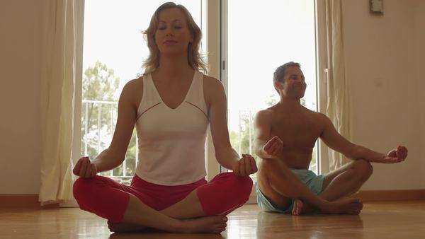 Couple meditating in exercise room. Royalty-free stock video