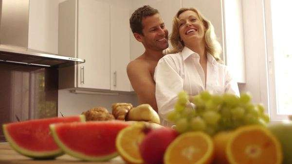 Happy couple in kitchen together. Royalty-free stock video