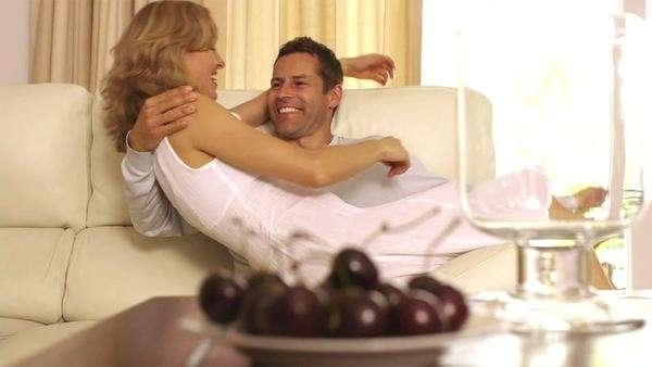 Slow motion shot of playful couple on couch. Royalty-free stock video