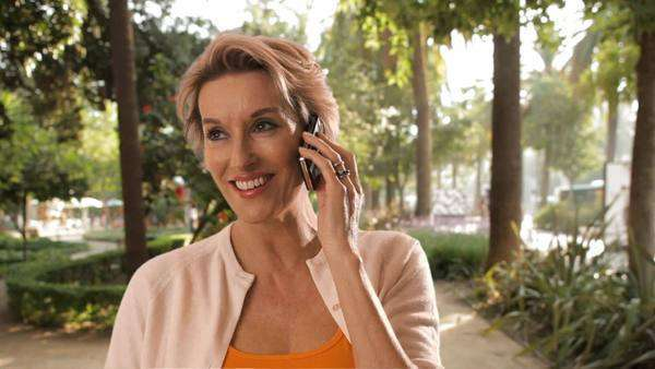 Woman in town talking on mobile phone. Royalty-free stock video