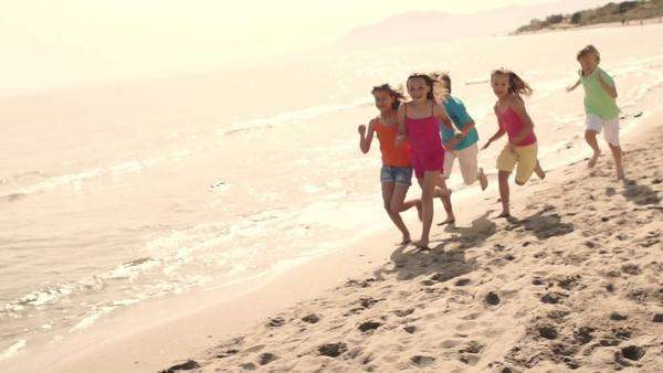 Slow motion of five children running on beach Royalty-free stock video