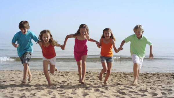 Lift up slow motion of five children running towards camera. Royalty-free stock video