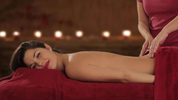 young woman having massage, candlelit background Royalty-free stock video