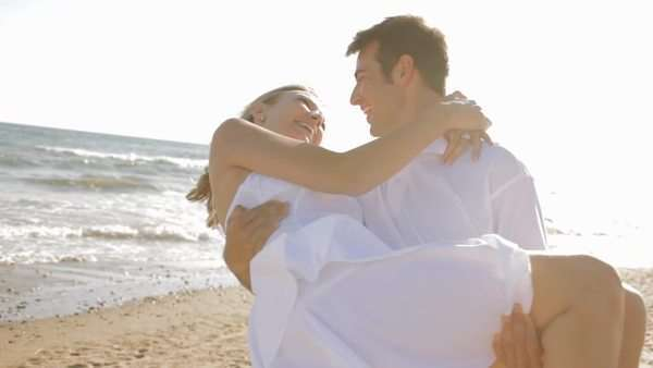 young couple twirling on beach Royalty-free stock video