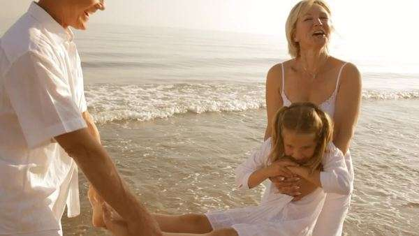 grandparents and granddaughter playing on beach Royalty-free stock video