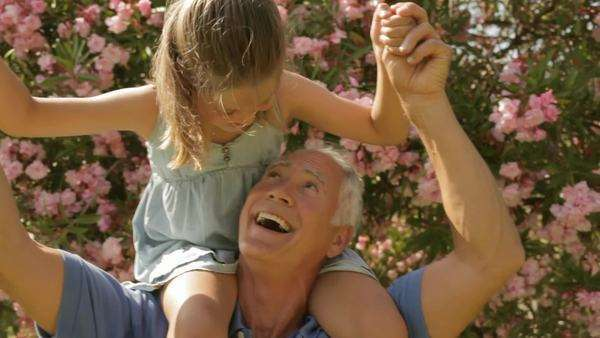grandfather and granddaughter playing in park Royalty-free stock video