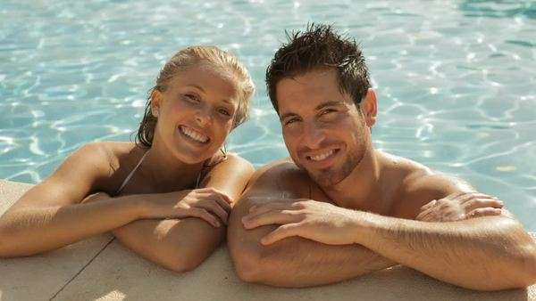 young couple laughing at side of pool Royalty-free stock video