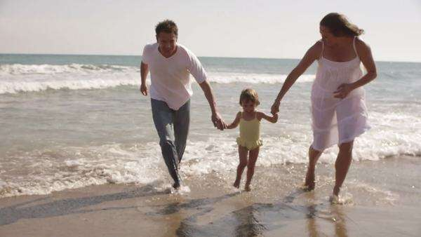Parents and daughter running out of sea. Royalty-free stock video
