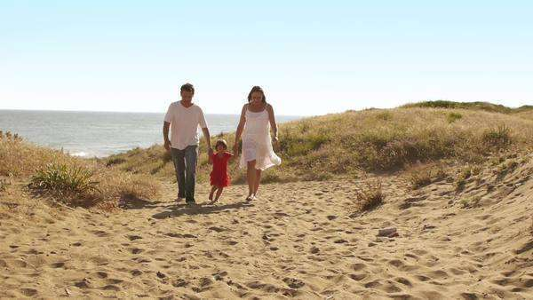Family walking on sand dunes to camera. Royalty-free stock video