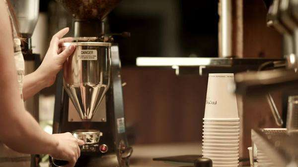 Barista preparing ground espresso for machine Royalty-free stock video