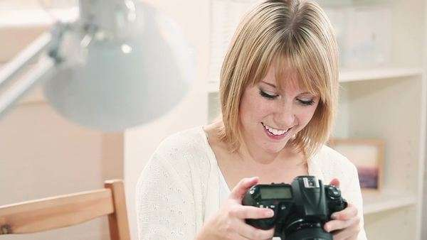 Photographer woman using camera at home Royalty-free stock video