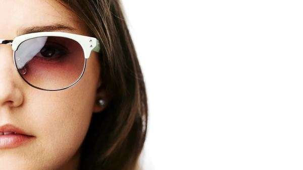 woman wearing sunglasses portrait close up half face character series isolated on pure white background Royalty-free stock video