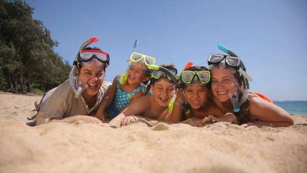Portrait of family laying on beach with snorkel gear Royalty-free stock video