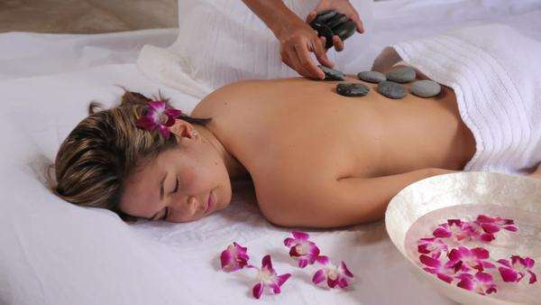 Woman gets hot stone spa treatment Royalty-free stock video