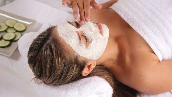 Woman at spa with facial mask and cucumbers Royalty-free stock video