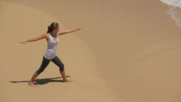 Woman doing yoga on beach, high angle view Royalty-free stock video