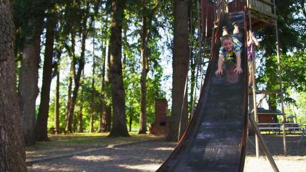Young boy going down slide at park Royalty-free stock video