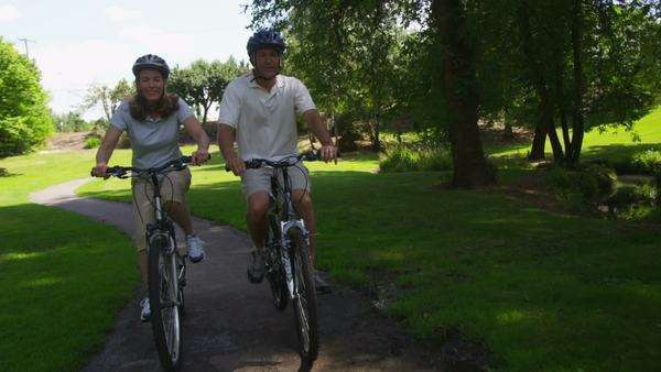 Mature couple riding bicycles, slow motion Royalty-free stock video