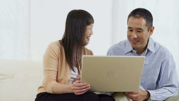 Portrait of Asian couple with laptop computer Royalty-free stock video