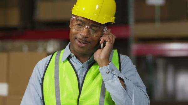 Industry worker using cell phone in shipping warehouse Royalty-free stock video