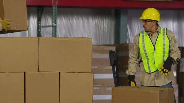 Industry workers stack boxes in shipping warehouse Royalty-free stock video