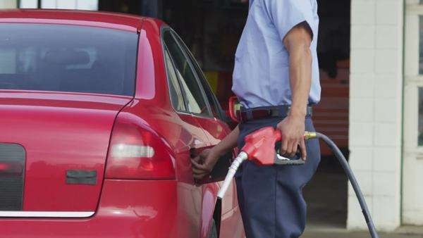Service station worker filling up car with fuel Royalty-free stock video