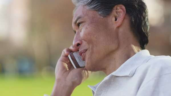 Senior Asian man talking on cell phone Royalty-free stock video