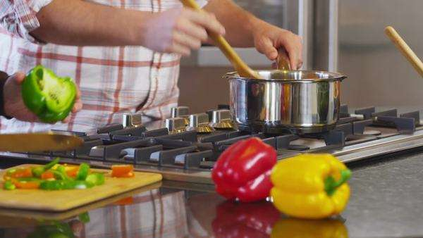 Couple in kitchen together prepare meal, closeup Royalty-free stock video