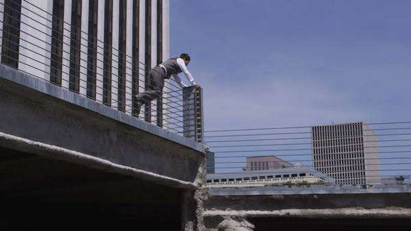 Businessman jumping over parking garage barriers Royalty-free stock video