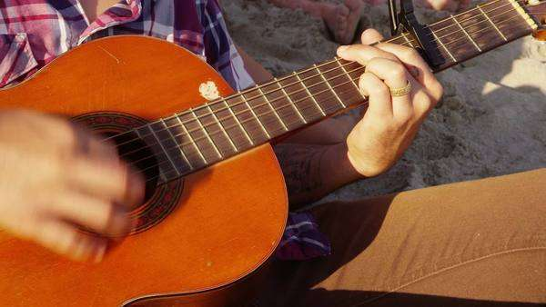 Close up of young person playing acoustic guitar Royalty-free stock video