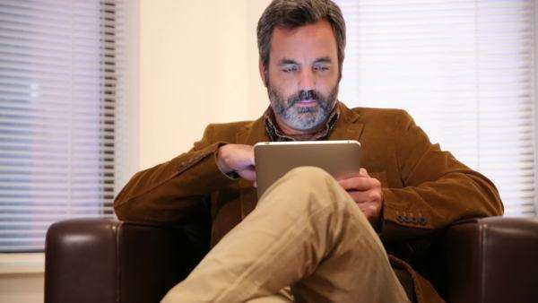 Man in hotel room using digital tablet Royalty-free stock video