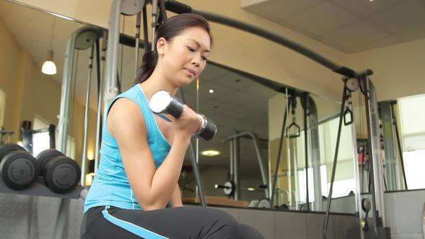 Woman exercising with dumbbells Royalty-free stock video