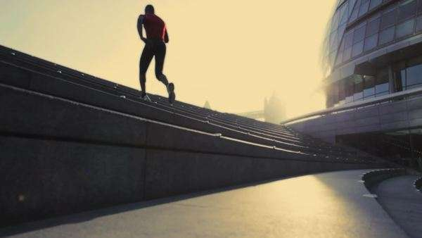 Runner on steps City hall London, UK, Slow motion, up, wide shot Royalty-free stock video