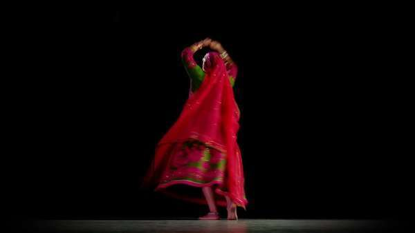 Indian woman in traditional dance costume dances against a black background  Full length shot, centred Royalty-free stock video