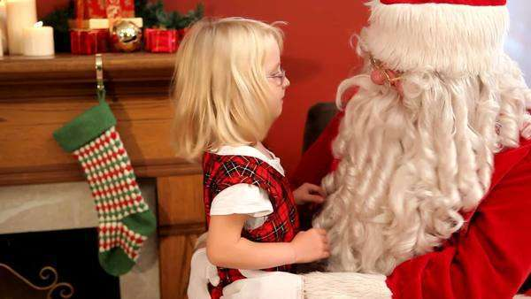 Young girl talking to Santa Claus Royalty-free stock video