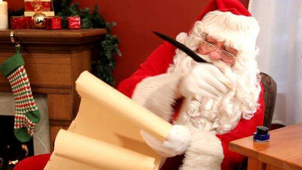 Santa Claus writing on scroll Royalty-free stock video