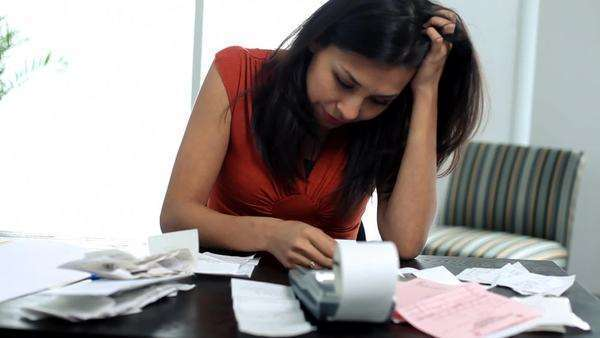 Distressed woman working on personal finances Royalty-free stock video