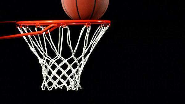 Basketball bounces on rim before falling in Royalty-free stock video