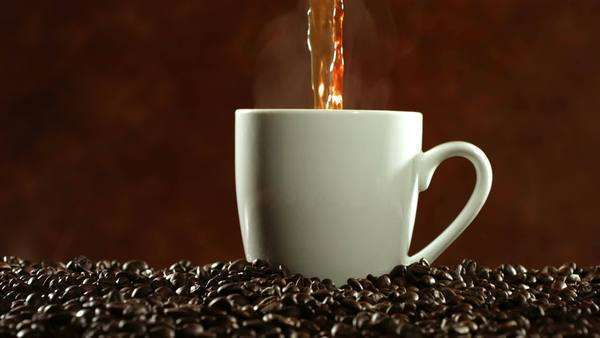 Coffee pouring and steaming, slow motion Royalty-free stock video