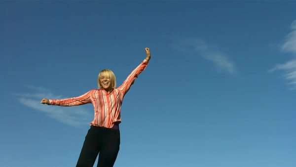 Happy woman jumps into sky, slow motion Royalty-free stock video