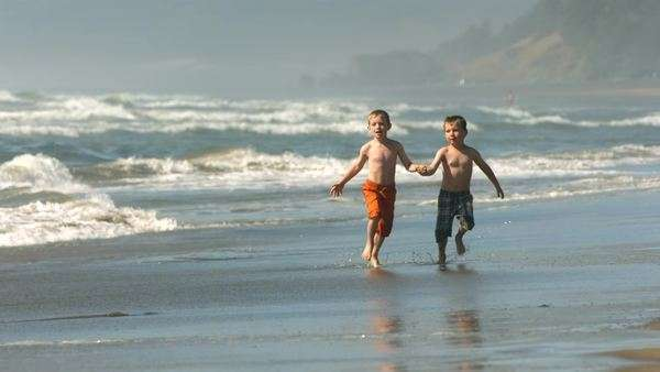 Young boys run on beach, slow motion Royalty-free stock video