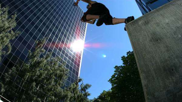 Three free runners jump over camera, slow motion Royalty-free stock video