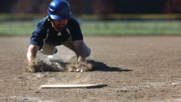 Baseball player slides into base, slow motion Royalty-free stock video