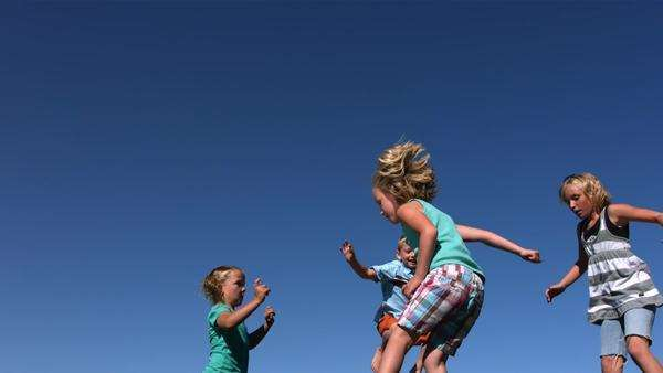 Kids jumping on trampoline, slow motion Royalty-free stock video